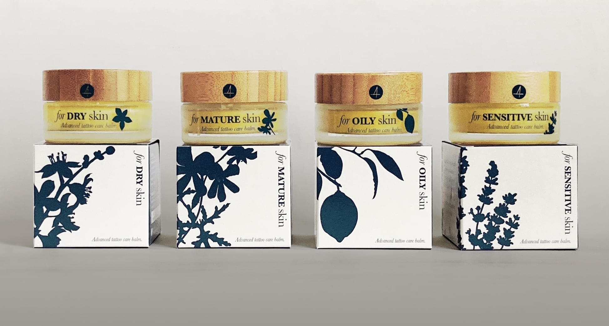 The four different boxes and their associated jar designs for Four Tattoo Care's balms. Differentiated by graphics and text.
